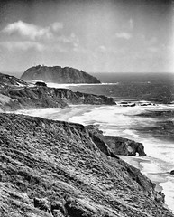Point Sur and Sea Arch (f0rbe5) Tags: ocean california statepark ca 2002 sea blackandwhite bw usa film monochrome rock 1974 arch pacific ae1 pacificocean restoration coastline volcanic rugged 1889 volcanicrock seaarch pointsur nationalregisterofhistoricplaces nrhp pointsurlightstation ruggedcoastline
