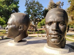 The Robinson Brothers (Thad Zajdowicz) Tags: cameraphone california park street trees light shadow portrait people sculpture art sports face mobile metal bronze mouth neck outside nose eyes outdoor cellphone ears bust turbo smartphone motorola publicart 365 athletes pasadena android droid jackierobinson commemoration 366 mackrobinson photoshopexpress zajdowicz