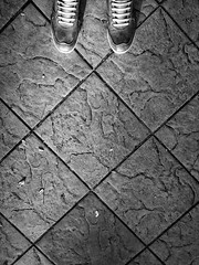 Look at your feet.. (0hasanul0) Tags: urban blackandwhite abstract detail texture geometric beautiful lines wall corner walking square shoe floor geometry walk background streetphotography dirty tiles shape