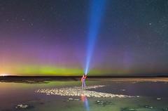 'Beam Me Up' - Lindisfarne Causeway, Northumberland (Kristofer Williams) Tags: sky beach night stars coast sand nightscape beam torch aurora figure lindisfarne northernlights auroraborealis causeway