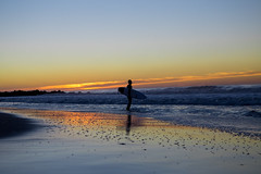 Surfer about to paddle out (Sidrancid) Tags: ocean nyc morning pink sunset shadow sky sun ny newyork beach sports silhouette sunrise out evening early big high sand solitude day waves surfer tide hurricane paddle sunny surfing atlantic clear joaquin surfboard late rockaway wetsuits