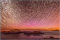 Trippy Star Trail (five15design) Tags: pink blue sea newzealand moon beach water clouds stars lights brighton purple southerncross aurora southisland otago dunedin brightonbeach milkyway southernhemisphere auroraaustralis galacticcore otagocoast coastaotearoa pacificoceaneveningnight