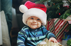 the goof (manyfires) Tags: christmas family portrait baby tree love film childhood analog 35mm infant holidays child son nikonf100 henry gifts presents santahat