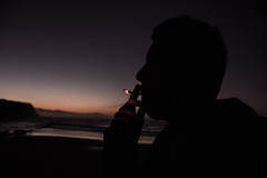Smoking (ainhoa.lopezdearregui) Tags: winter sunset beach colors contrast relax lights seaside shadows chilling basquecountry silouettes gipuzkoa goodvibes zumaia softtones basquecoast