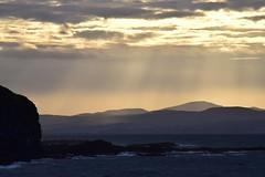 Donegal rain (skippyjon2010) Tags: ireland sunset sea mountain beach rain rock shower rocks waves n wave atlantic northern donegal portrush antrim