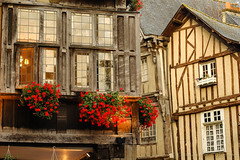 Dinan (Brittany): half-timbered buildings (clodio61) Tags: street wood old city flowers sunset red urban house france color building architecture facade photography evening brittany europe day cityscape exterior outdoor bretagne historic typical halftimbered dinan cotesdarmor