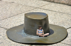 The Hat Trick (swong95765) Tags: sculpture man scale hat book gut sitting metallic size seated crosslegged porportional
