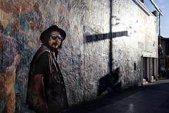 untitled (feldmanrick) Tags: park street light urban color berkeley mural fuji cross outdoor candid homeless streetphotography peoples fujifilm unposed powerful decisivemoment rickfeldman