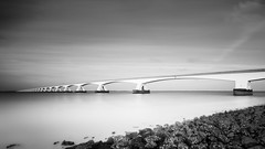 Zeeland Shore mono (frank_w_aus_l) Tags: longexposure bridge sky bw holland water netherlands monochrome architecture wow noiretblanc smooth wideangle zeeland architektur nl niederlande zeelandbrug colijnsplaat zeelandbrcke nikondf