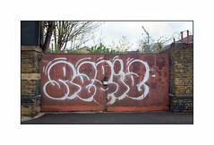 Graffiti (Rabid), East London, England. (Joseph O'Malley64) Tags: uk greatbritain england streetart london tarmac graffiti mural paint britain gates spray british cans aerosol brickwork razorwire rabid eastend eastlondon padlocks towercrane muralist padlocked sycamoretrees antivandalpaint meshfencing victorianstructures securityspikes granitekerbing tactilepavingforthevisuallyimpaired