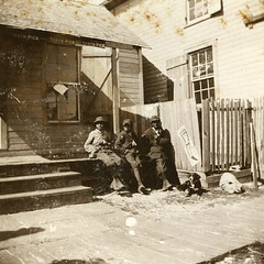 Three African American boys in Apalachicola (State Library and Archives of Florida) Tags: pets dogs children florida advertisements apalachicola africanamericanchildren