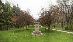 Monument In The Orchard (Dan Constien) Tags: county trees monument orchard health madison dane mendota wi mental madisonwisconsin bokehpanorama brenizereffect sonya7