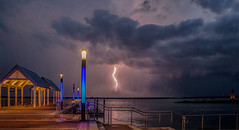 Lightening at the docks...HDR (tshabazzphotography) Tags: nightphotography lighthouse nightshot bolts lightening kissimmee nightphotos longshutterspeed lighteningbolt lighteningstrike longexposurephotography t5i photographylife kissimmeelighthouse kissimmeelakefront photographyiislife