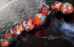 Rocks Orange Pine Amethyst Frosted (Laura Blanck Openstudio) Tags: pink red etched orange usa green glass leaves set pine garden beads big bottle rocks colorful glow purple handmade stones shapes violet lavender funky jewelry pebbles made odd lilac earthy mango faceted opaque bead bracelets amethyst organic transparent wearable nuggets murano maize lampwork beaded multicolor raku suede matte whimsical loose necklaces frit openstudio abstrac asymmetric ocher tumbled focals openstudiobeads