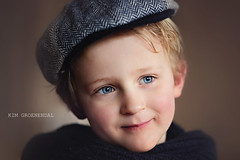 Beautifull portrait (kim groenendal) Tags: blue portrait blur color netherlands smile up eyes fuji dof close nederland cap blond mooi portret tone lief beautifull almere childphotographer childphotography qute kinderfotografie fujixt1