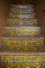 ali qapu palace decorated stairs, Isfahan Province, isfahan, Iran (Eric Lafforgue) Tags: art history tourism yellow vertical architecture stairs design persian ancient asia stair iran islam traditional steps culture persia nobody palace architectural historic indoors tiles staircase imperial historical sight esfahan islamic isfahan tilework ispahan  aliqapu qapu placeofinterest   iro isfahanprovince  builtstructure colourpicture  hispahan timuriddynasty irandsc08512