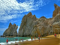 Lovers Beach Cabo San Lucas 2008 (Kirt Edblom) Tags: ocean blue sea vacation beach water rock landscape mexico outdoors coast sand cabo nikon rocks waves pacific outdoor scenic july bluesky pacificocean landsend coolpix wife coastline baja bajacaliforniasur 2008 hdr cabosanlucas seaofcortez bcs waterscape rockformation gulfofcalifornia elarco loversbeach gaylene easyhdr p5100