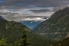 Leaving Skagway (wimvandemeerendonk) Tags: ocean blue trees sea wild sky usa cloud sun mountain snow canada color colour tree green nature water colors rock alaska clouds contrast forest landscape outdoors rocks colours unitedstates outdoor sony glacier skagway yukon land faves insidepassage monumental icefield mountainscape oceaan pacificpcean rockpaper 100149 simplysuperb daarklands wimvandem