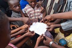 LETTER TO ELDERS. Ayegbami, Ikorodu North, 2015. (cadi.cliff) Tags: africa travel portrait west children democracy hands faces state streetphotography photojournalism lagos together westafrica nigeria letter activism socialchange ikorodu youthdrivenchange