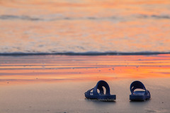 A couple of slipper on the beach at sunset. (baddoguy) Tags: sunset sea seascape beach horizontal thailand outdoors photography shoe twilight loneliness tranquility wave nopeople copyspace vacations slipper scenics tranquilscene traveldestinations colorimage beautyinnature tratprovince