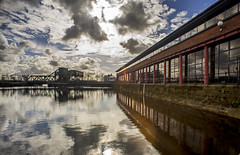 Birkenhead Dockland (Richard Littler) Tags: reflection clouds canon wideangle manual wirral merseyside fl19mmf35