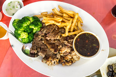 sliced steak with broccoki and french fries (danny4stockphoto) Tags: red food tomato blood eating beef salt fork frenchfries meat slice steak barbecue rosemary cooked grilled rare seasoning roasted cuttingboard salted cherrytomato ribeye tableknife blackanguscattle woodenbackground aberdeenanguscattle preparedpotato servingboard carvingset woodmaterial pepperseasoning
