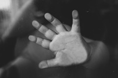 Hard pressed (kblackfoto) Tags: blackandwhite bw baby glass monochrome childhood composition canon rebel kid toddler moody hand fineart fingers perspective monochromatic palm t5 highfive matte pressed babyhand waterspots littlehand phalanges givemeahand hardpressed