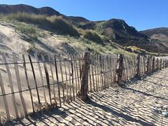 Morfa Conwy (beatraxa) Tags: shadow beach wales fence coast sand dune shore conwy northwales morfa