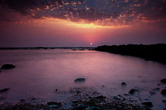 Sunset | Mumbai | Bandra bandstand #2 (singhajaydotcom) Tags: ocean longexposure sunset sea sky india seascape beach beautiful rock clouds landscape evening coast nikon sundown indian mumbai clours travesl