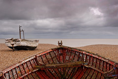 Two Belles. (Andy Bracey -) Tags: sea two seascape beach landscape boats coast suffolk fishing nikon cloudy stormy pebbles coastal northsea ribs seafront fishingboats aldeburgh beachfront wrecked belles bracey d700 twobelles andybracey