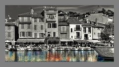 Reflecting Colour (Andy Gant) Tags: cassis france provence southoffrance architecture architectureinpixels boats fishingboats water watereffects bwphotography selectivecolour bw bweffect bwimages bwimagesfromaroundtheworld colours colors colour color harbour buildings mono cafescene walls windows wow