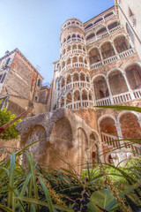 Venice: Scala del Bovolo (Steve_66) Tags: travel blue venice vacation sky italy plants holiday building green tower history architecture canon europe perspective foliage historical venetian venezia lowlevel scaladelbovolo stevenolan