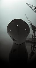 Ghost Ship (Lesy83) Tags: uk longexposure shadow blackandwhite bw mist reflection london silhouette fog night hotel dock ship ghost spooky docklands phantom