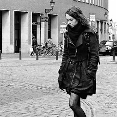 In Thoughts (Akbar Simonse) Tags: people bw woman holland blancoynegro netherlands monochrome square zwartwit candid nederland streetphotography denhaag bn haag thehague vierkant lahaye sgravenhage agga straatfotografie inthoughts dscn8409 akbarsimonse