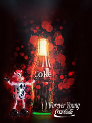 02468808-72-Coca Cola Forever Young-19 (Jim There's things half in shadow and in light) Tags: advertising poster toy cow bottle bubbles coke plastic cocacola cokebottles winduptoy