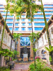 Hot Outside and Cool Inside (Steve Taylor (Photography)) Tags: city blue brown white plant hot flower building tree art window glass up leaves architecture digital circle square hotel cool bush singapore asia calm palm foliage tall lush humid