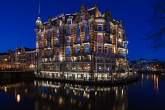 The life of luxury (McQuaide Photography) Tags: city blue winter light urban holland reflection water netherlands dutch amsterdam architecture zeiss photoshop river outside hotel licht twilight lowlight europe waterfront outdoor dusk sony famous tripod capital nederland wideangle landmark illuminated adobe bluehour fullframe alpha 16mm luxury waterside nationalmonument stad 5star amstel manfrotto noordholland lightroom fivestar wideanglelens capitalcity 1635mm northholland a7ii groothoek hoteldeleurope luxuryhotel variotessar rijksmonument mirrorless sonyzeiss mcquaidephotography ilce7m2