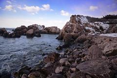 Snowy Rocky Coast (Tomekin) Tags: ocean new blue winter sea england sky snow nature water coast waves snowy maine rocky atlantic winding vacationland
