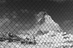 *** (Misha Sokolnikov) Tags: leica sky blackandwhite bw alps nature monochrome landscape 50mm mono switzerland pattern noiretblanc barbedwire zermatt matterhorn monochrom blackwhitephotos aposummicron leicamonochrom leicamm