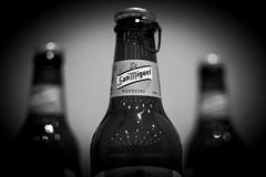 013/365 Beer and lights (Rubn RG) Tags: bw beer contrast 35mm bottle nikon bokeh 365 sanmiguel d3100