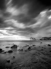 El Charco amenazante B&N (joaquinain) Tags: sea bw white black blanco clouds mar long exposure mediterraneo voigtlander negro paisaje olympus bn nubes marino omd larga em1 exposicin seascpae