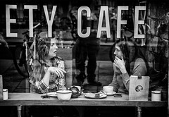 cafe window (Daz Smith) Tags: city uk portrait people urban blackandwhite bw streets reflection blancoynegro window coffee monochrome canon blackwhite cafe bath drink candid citylife thecity streetphotography talking canon6d dazsmith bathstreetphotography