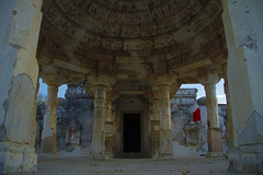A temple at evening (wajahat.baloch) Tags: door old blue pakistan sunset red orange temple evening ancient symmetry passage sindh