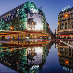 Les Galeries Lafayettes se ddoubles ! (Frankyyy007) Tags: road street blue light sunset sky paris france reflection building water colors architecture night buildings pose painting puddle lights europe long exposure angle sony wide trails route trail exposition hour lighttrails alpha rue extrieur reflets 6000 longue
