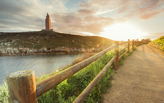 Just another day...(Explored) (Eduardo Regueiro) Tags: ocean light espaa sun sunrise landscape spain corua monumento calm galicia torredehercules herculestower