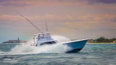 Sportfish and Breakers (srotag1973) Tags: ocean beach water boats boat florida spray palm atlantic sportfish