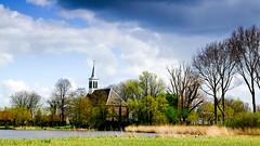Waterland - the village church (Boudewijn Vermeulen) Tags: blue green water grass clouds landscape bomen groen blauw skies meadows wolken gras landschap waterland luchten sloten ditches publ