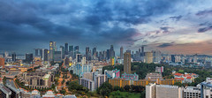 Singapore Cityscape at Sunset (David Gn Photography) Tags: city travel sunset sky panorama tourism skyline modern clouds buildings shopping evening singapore downtown apartments cityscape realestate view skyscrapers dusk towers scenic property entertainment cbd hotels residential hdb metropolitan offices condominiums singaporeriver cntralbusinessdistrict