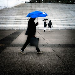 Under protection (tomabenz) Tags: blue paris umbrella rainyday streetphotography streetview ladfense