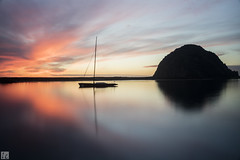 Morro Bay 037A1350 (lycheng99) Tags: california sunset red sky water silhouette rock reflections boat dusk pacificocean morrobay redsky morro pacificcoast goldenhour silky californiacoast rockformation goldenmoment 2016sansimeon